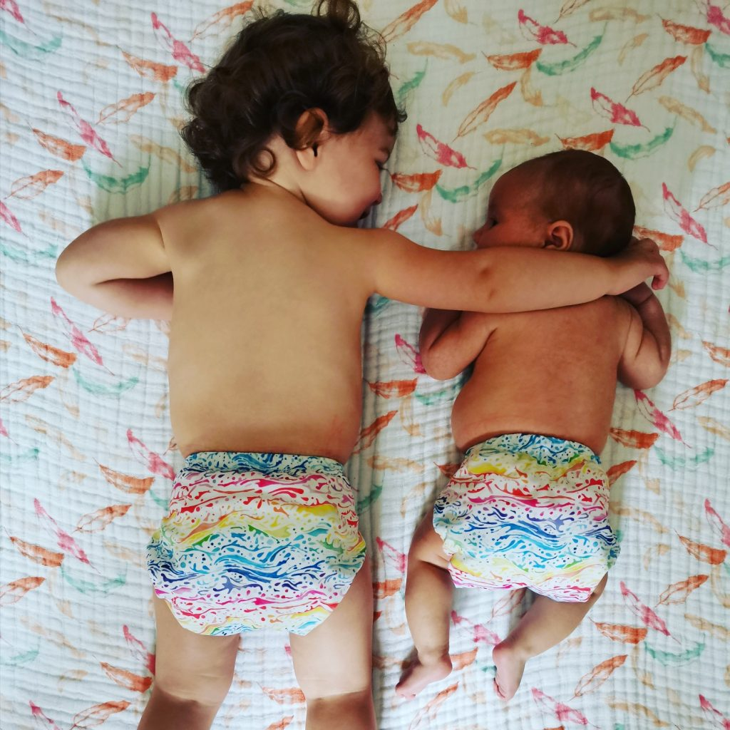 Two children in cloth nappies